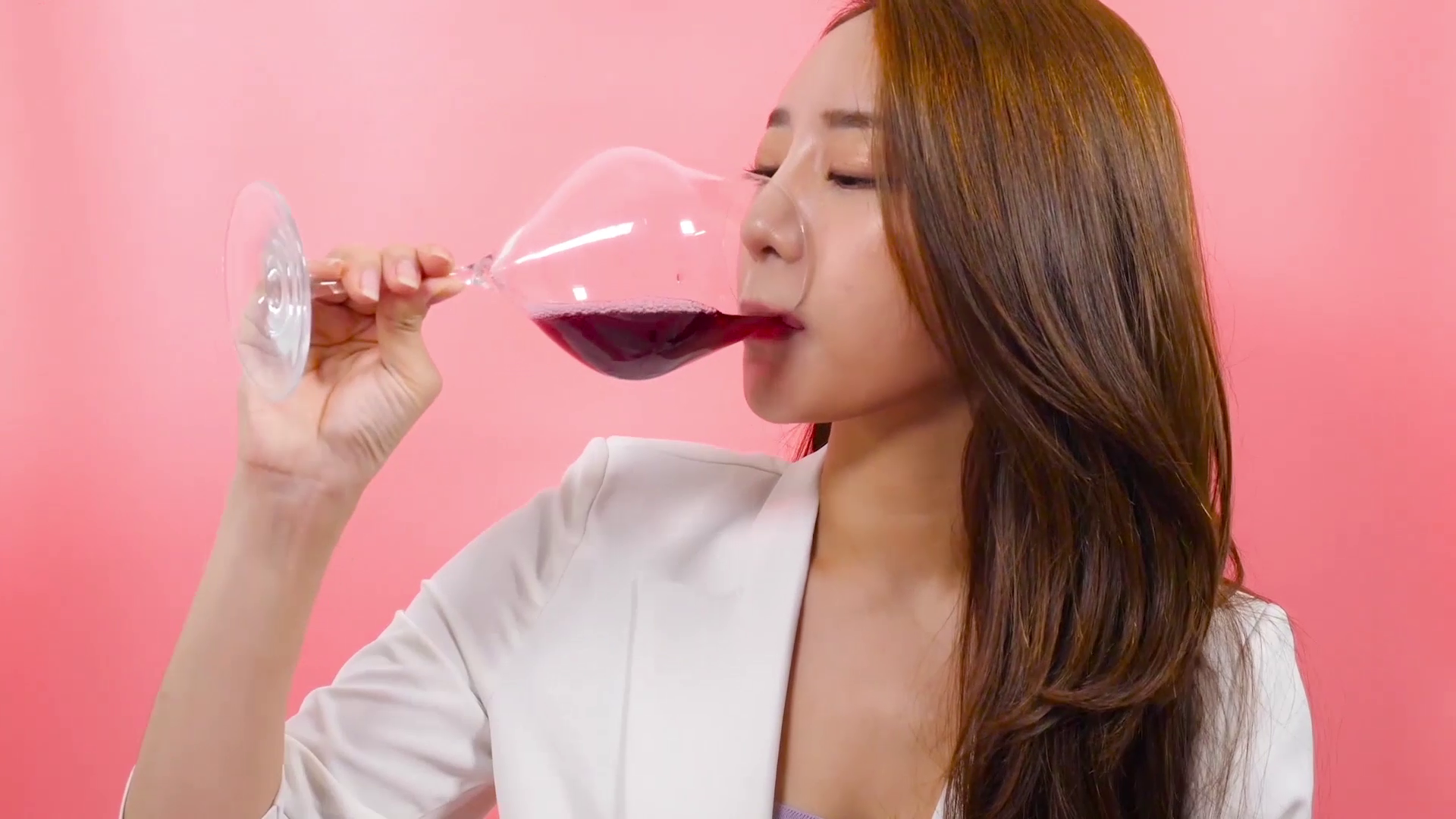Woman drinking wine with the Vintorio Wine Aerator Pourer