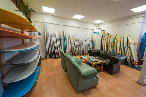 surfboard room at mango surf