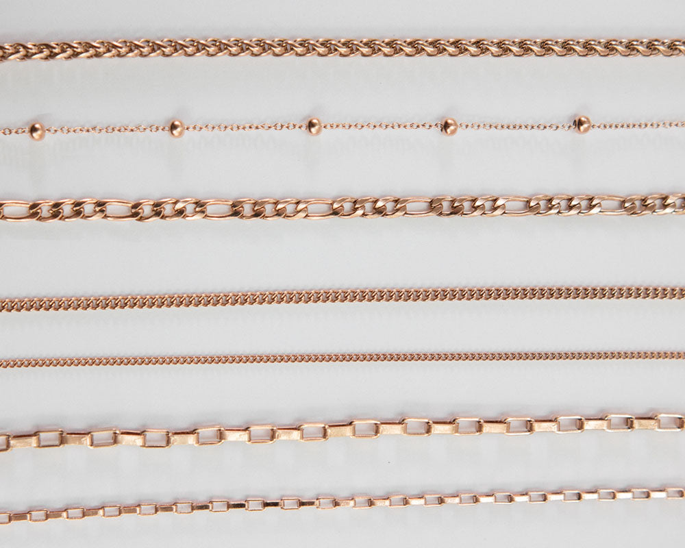close up detail of rose gold chain textures by the hexad