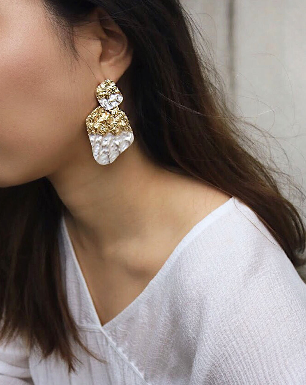 Add a real touch of midas with these textured gold and silver drop earrings - The Hexad