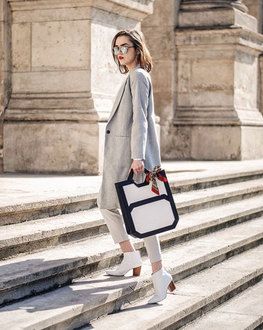 Andreea Birsan of Couturezilla.com models The Hexad leather tote bag in white blazer suit