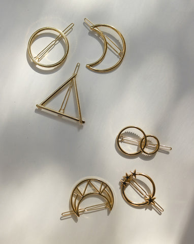 Assorted hair barrettes in gold in a variety of shapes - classic circle, triangle, stars, crescent shape and more - TheHexad