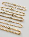 Assorted chain bracelets in gold by The Hexad