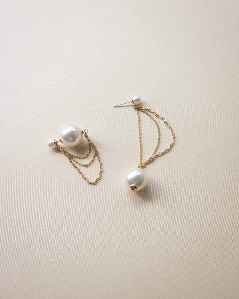 assymmetrical style earrings with pearls and gold chains by The Hexad