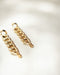 Bold golden earrings for contemporary fashion - The Hexad
