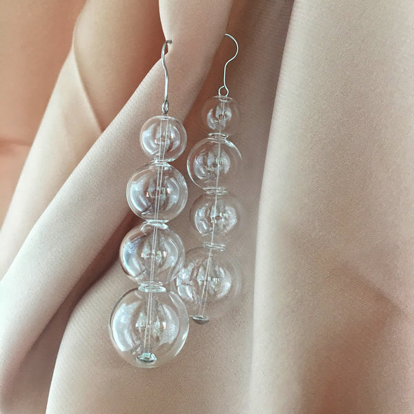 Crystal Ball Inspired Dangling Earrings by The Hexad Jewelry