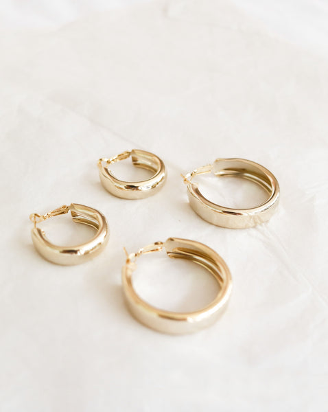 Chunky gold hoops in a subtle champagne gold hue - The Hexad Earrings