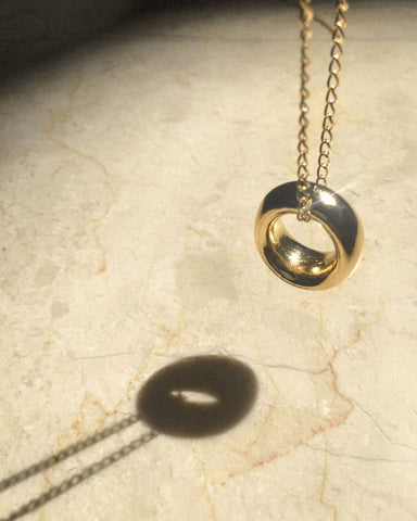 Chunky gold ring pendant worn on a chain as a necklace - The Hexad Jewelry