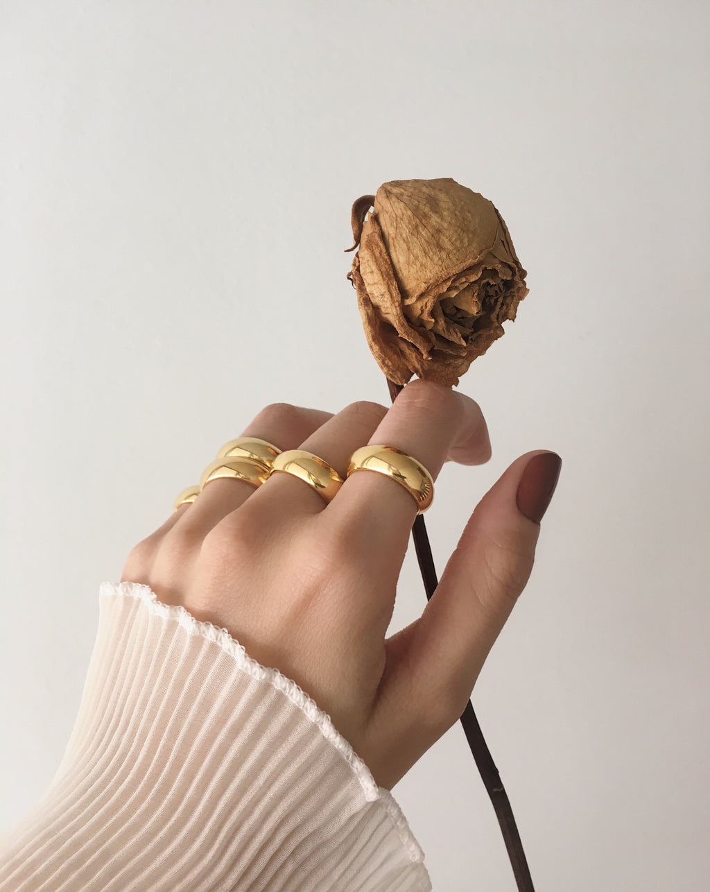 Chunky gold rings worn together for a stacked effect - Affirmation Ring by THEHEXAD