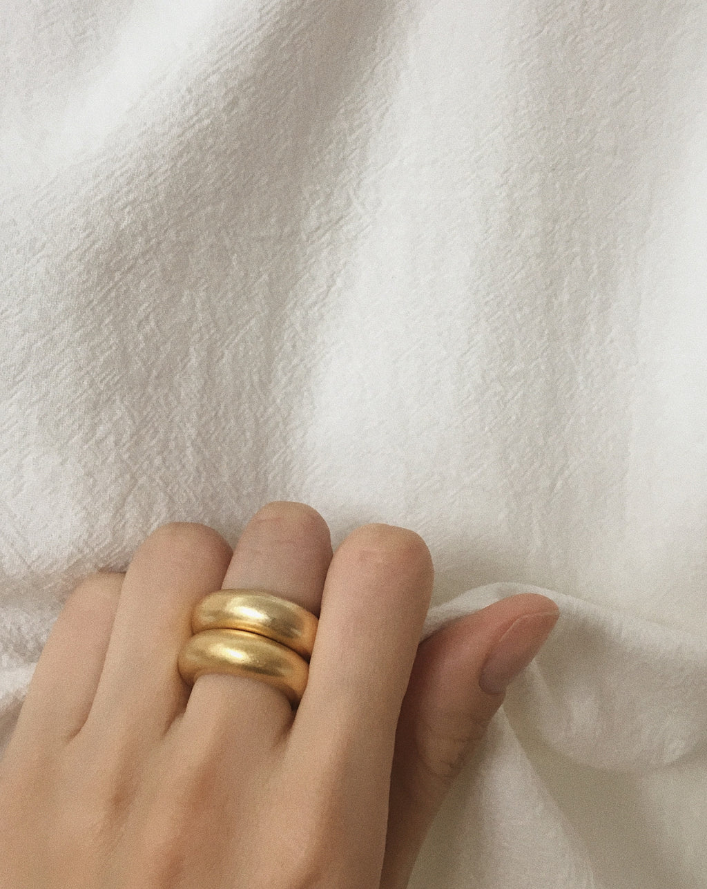 Chunky matte finish gold rings stacked together - The Hexad