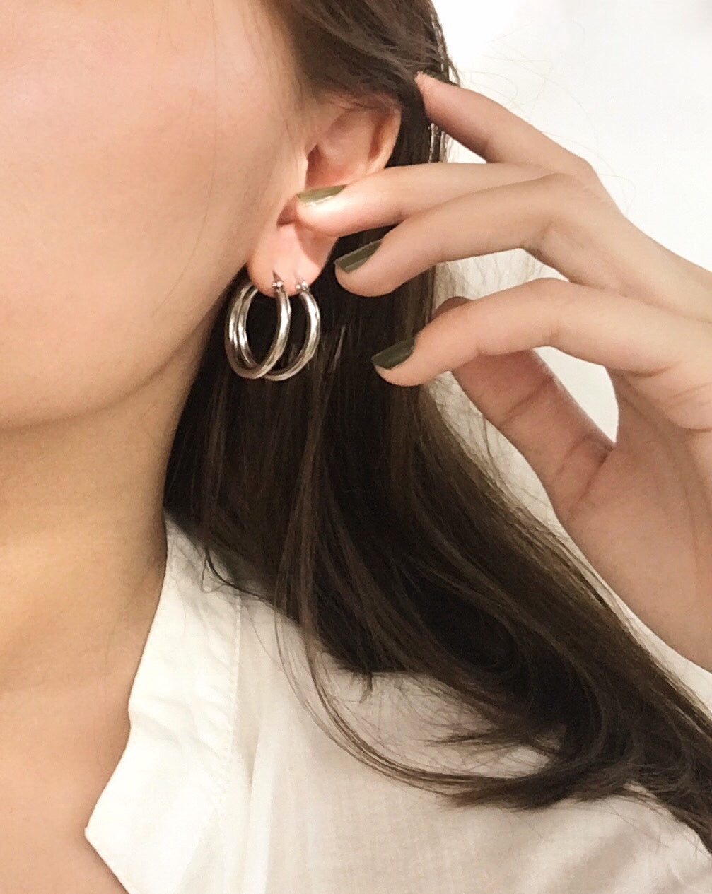 Double stacking the 26mm silver hoop earrings by THEHEXAD