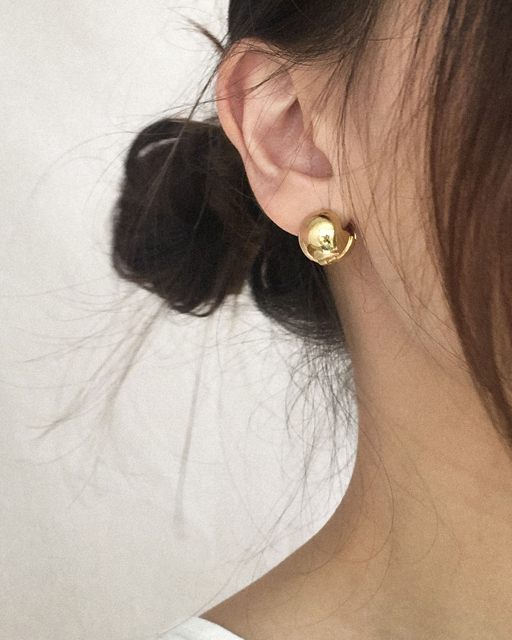 Classy golden ball earrings worn as a ear stud - The Hexad