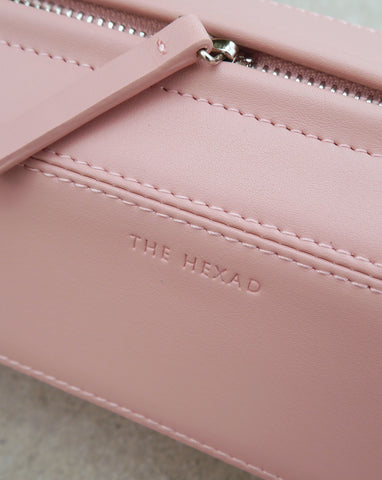 Close-up details of the hexagon shape prism crossbody bag featuring smooth, dusty shell pink genuine leather- The Hexad Bags