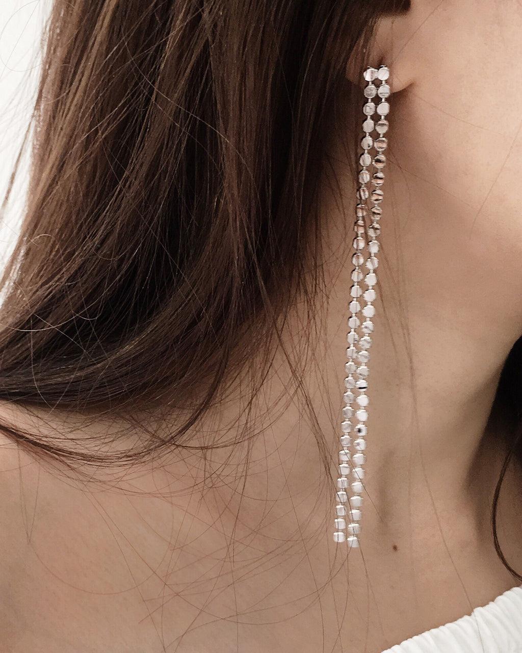Close-up details of the silver Lola Double Dangle Drop Earrings - The Hexad Jewelry