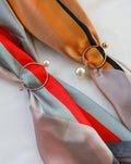 Close up details of the Cirque Scarf Rings - a modern chic way to hold your scarf or bandana in place - TheHexad