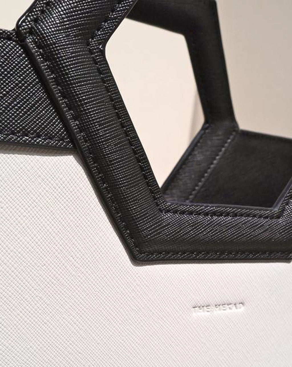 Close up details of the hexagonal shape handle of the AVA Tote Bag by The Hexad