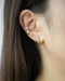 Curated ear stack with minimalist ear cuffs and pentagon hoops by The Hexad