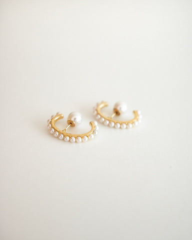 Curved suspender earrings embellished in pearls with a pearl stud ear backing - @thehexad