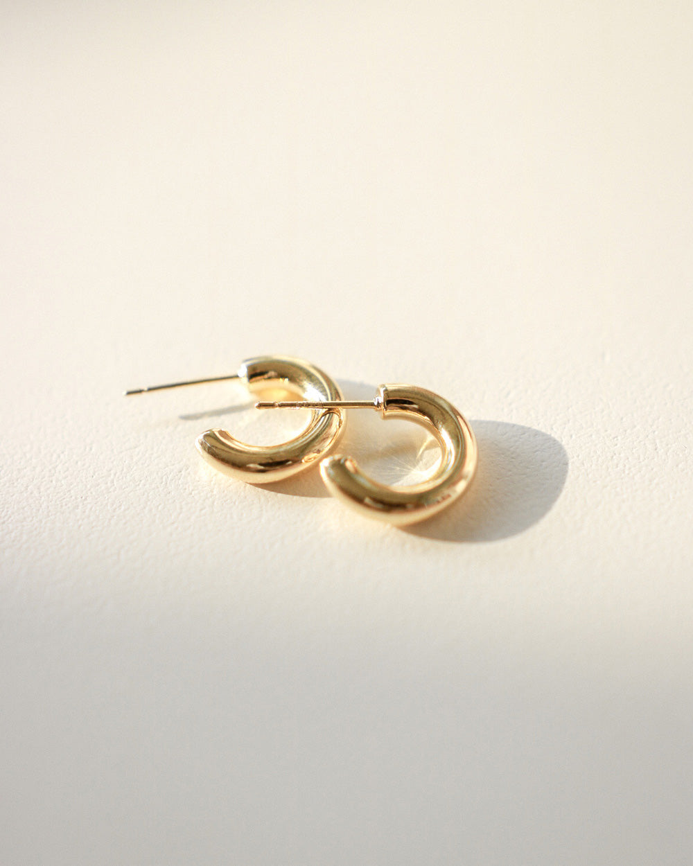 Cute minimalist gold hoop earrings by The Hexad
