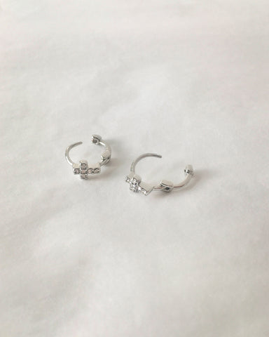 Dainty silver cross huggie hoops with tiny sparkly rhinestones - The Hexad Jewelry