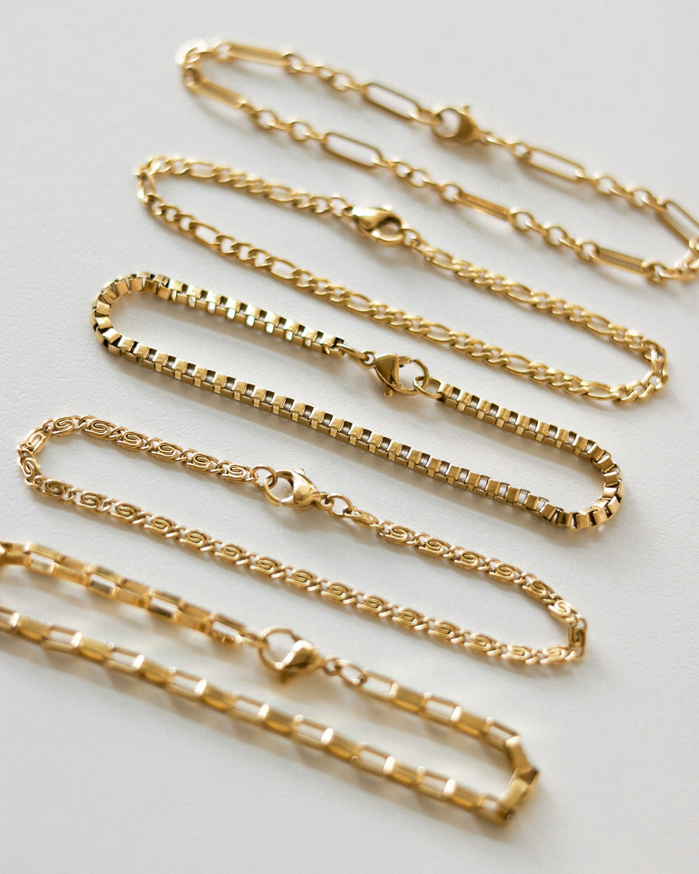 Delicate chain bracelets that are perfect for stacking - The Hexad
