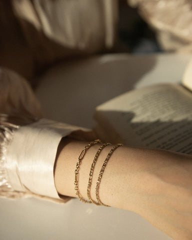 Delicate thin layering bracelets on the wrist @thehexad