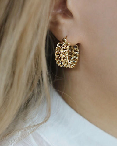Double chains intertwined to form a chunky gold hoop earring - The Hexad