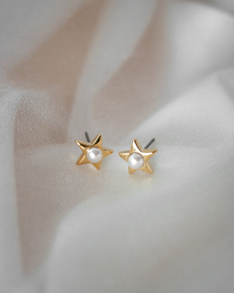 Dreamy earrings featuring a petite pearl set in a star - Belle by The Hexad