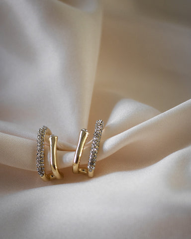 Duet suspender earrings feature a simple gold bar with a rhinestone encrusted bar @thehexad