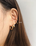 Ear party stack with the Retractable hoops worn as a lobe and conch piercing - The Hexad