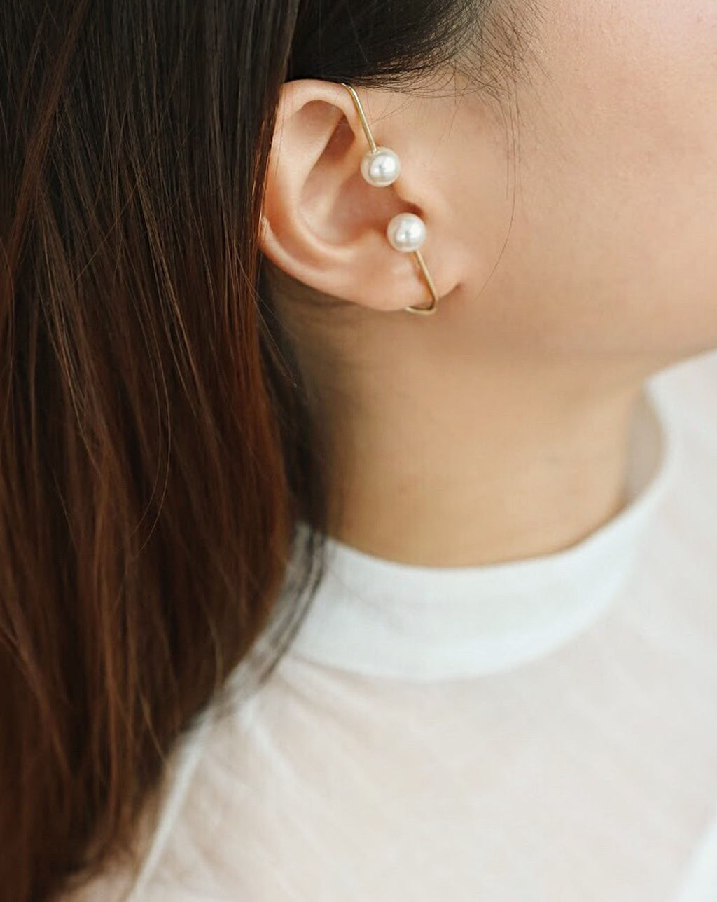 Edgy yet classy pearl ear cuff in gold - The Hexad Jewelry