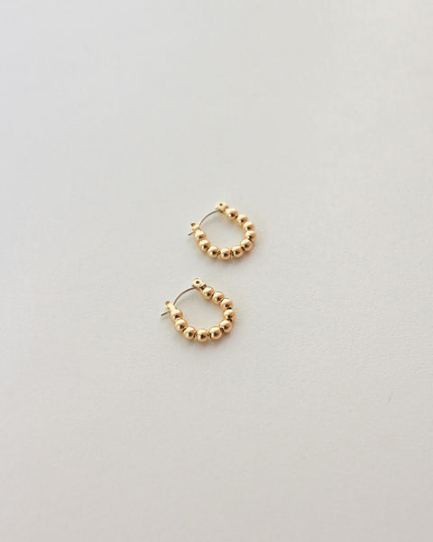 Emi beaded ball hoop earrings in gold by The Hexad