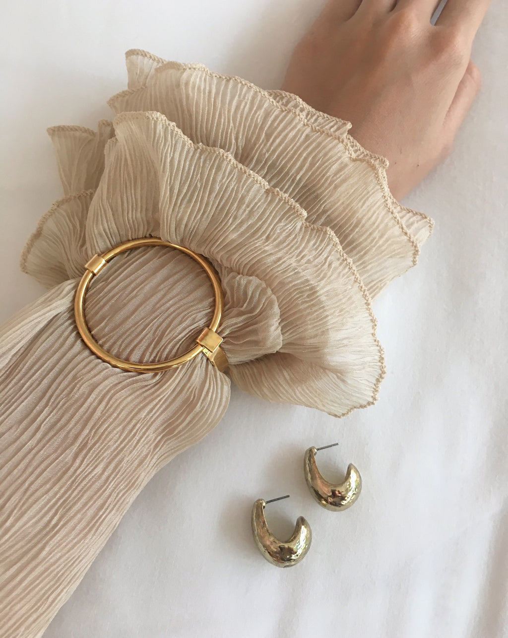 Fabienne Circle Bangle styled with a vintage pleated crepe beige color blouse - The Hexad Jewelry