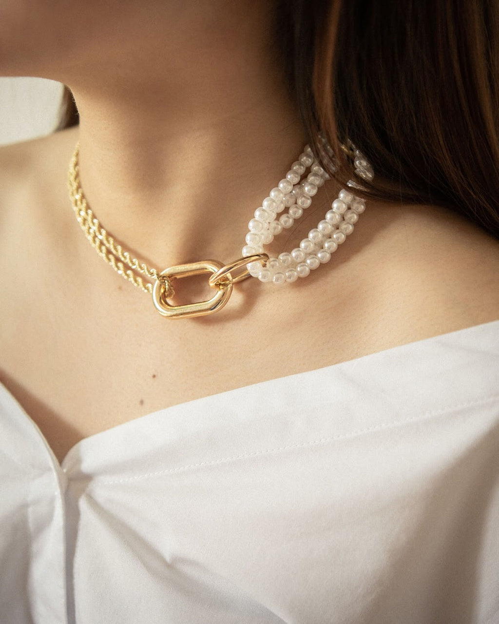 Unique women's choker chain necklace featuring a mix of gold chains and pearls - Shop the Isabeau necklace at thehexad.com