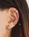 Fake your conch piercing with these Retractable ear cuffs - The Hexad Jewelry