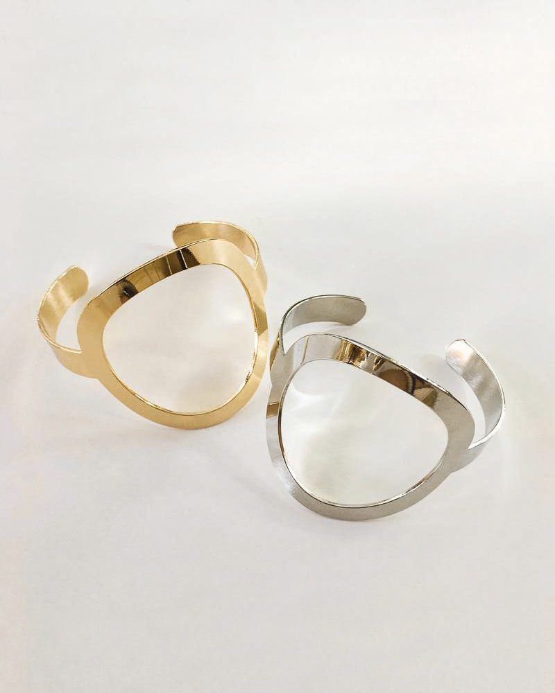 Geometric inspired oval shape bangles in gold and silver - The Hexad