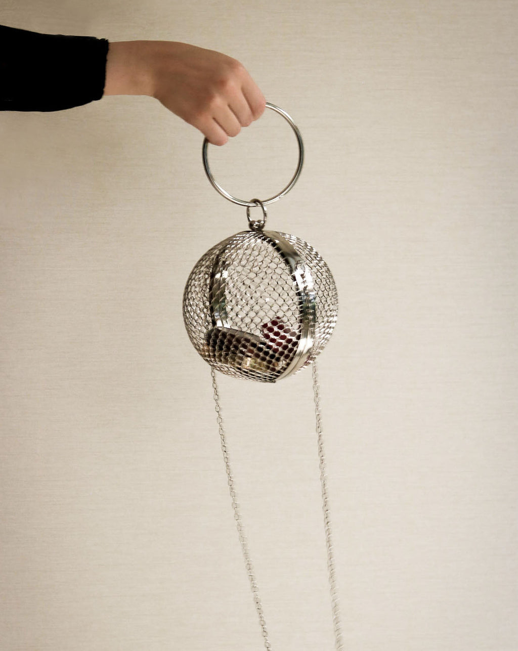 Geometric silver cage bag carried as a clutch or with a detachable chain - TheHexad
