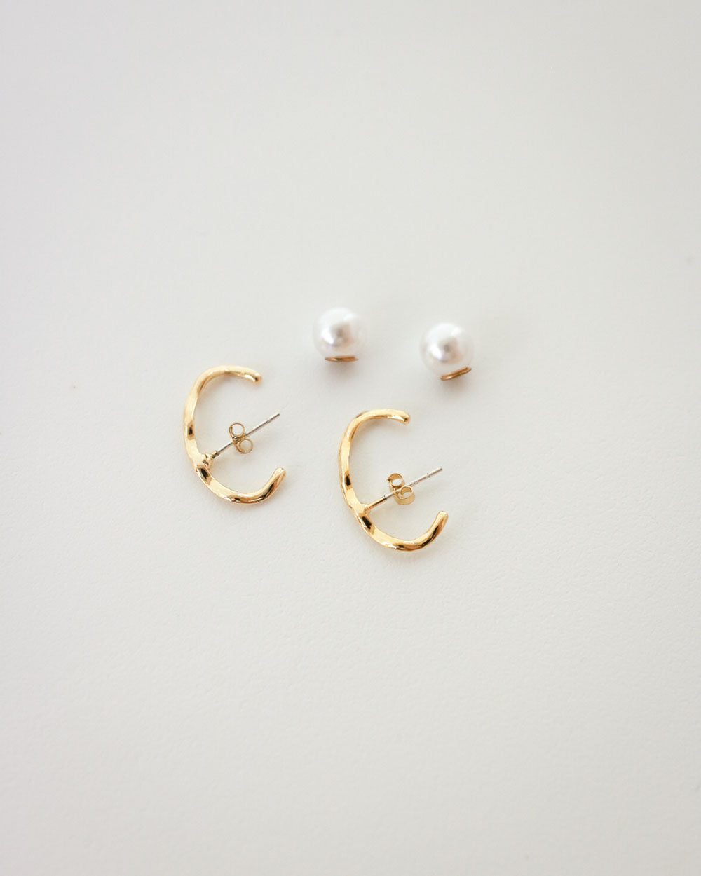 Gold Wavy Suspender Earrings by The Hexad