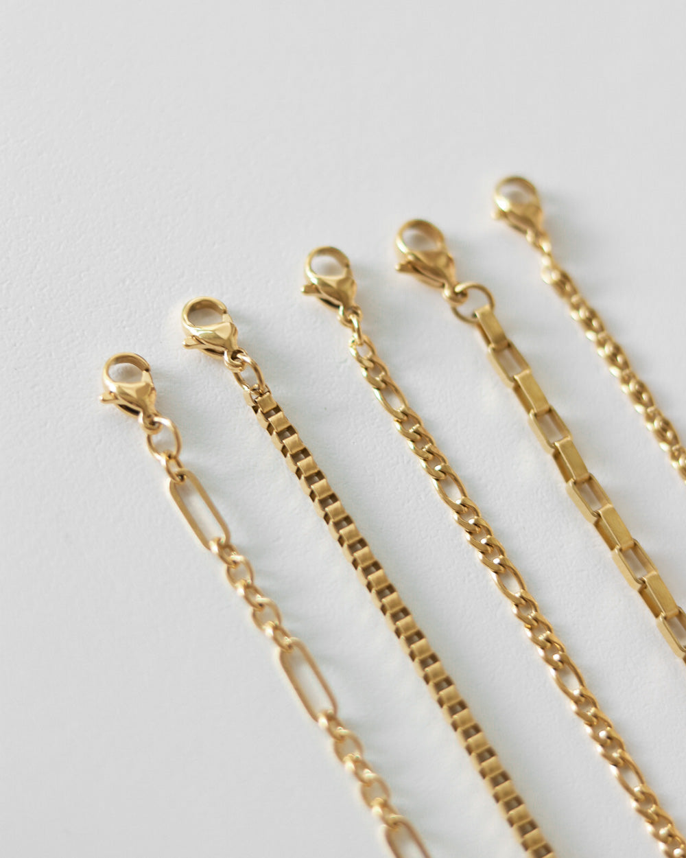 Gold chain bracelets by The Hexad Jewelry