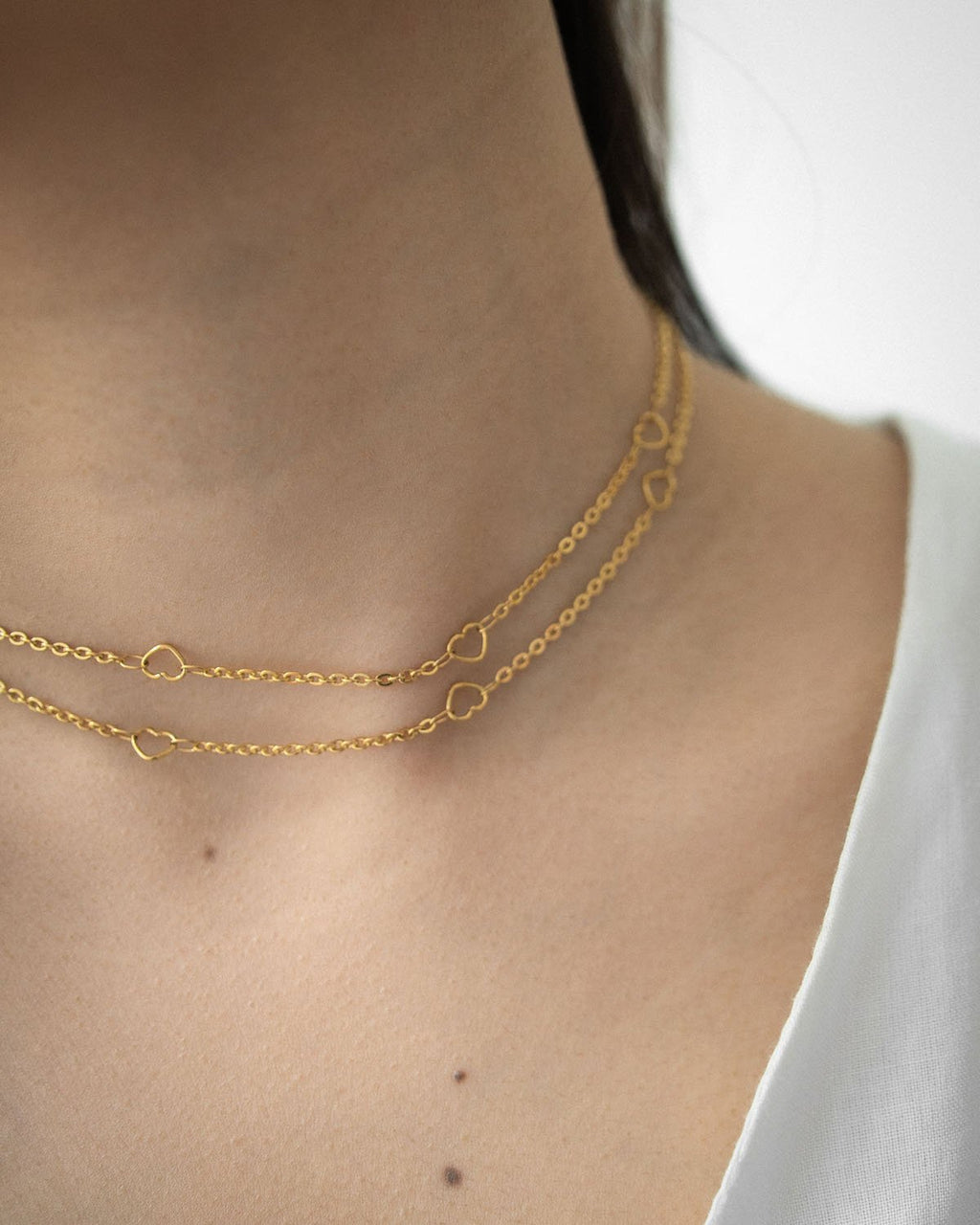 Gold chain necklace featuring cute tiny cut-out hearts @thehexad