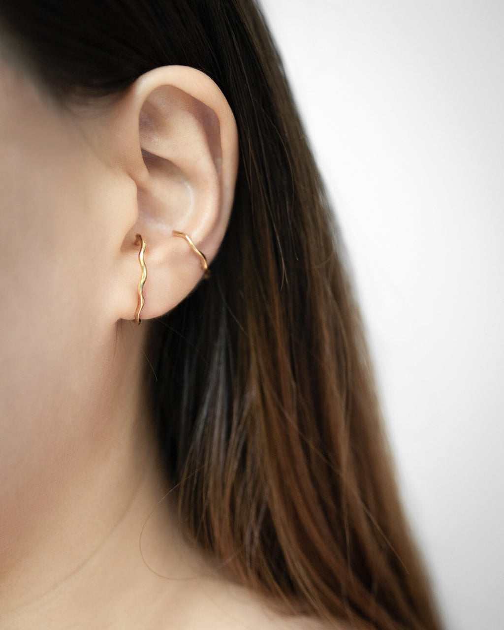 Gold plated wavy design earrings that hug your earlobes - Yvette suspender earrings by The Hexad