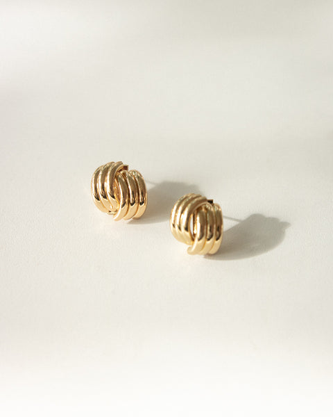 Stylish golden ear studs for chic everyday wear