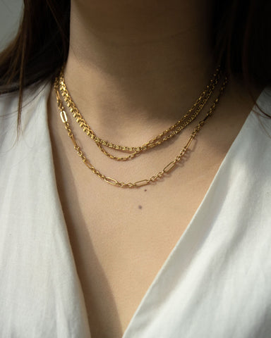 How to layer multiple gold necklaces by The Hexad Jewelry