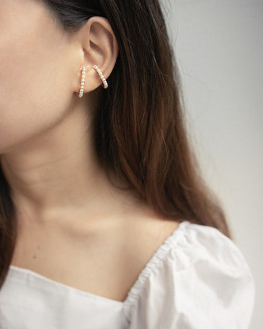 How to layer on suspender earrings on multiple ear piercings - The Hexad