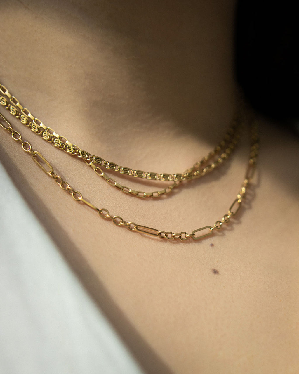How to rock that multiple gold necklaces look by The Hexad Jewelry