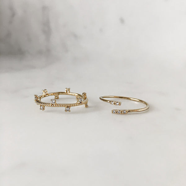 set of two delicate gold thin bands with zirconia stones