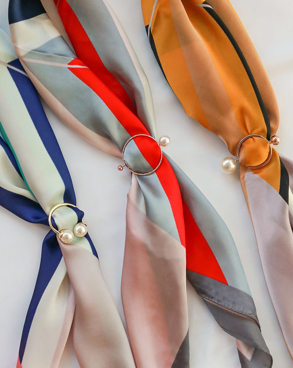 Keep your scarves and bandanas in place by looping them through these modern chic scarf rings - TheHexad