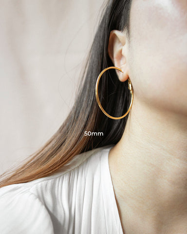 Large and skinny 50mm gold hoop earrings - The Hexad