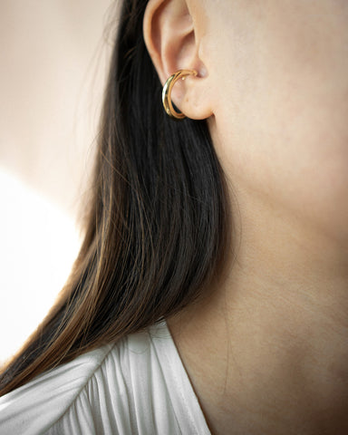 Large chunky golden ear cuff for pierceless ears - The Hexad Jewelry