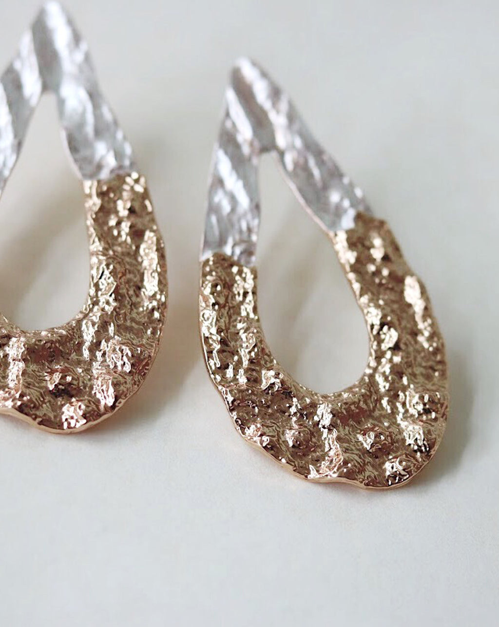 Lava-esque textured earrings in a two-tone gold and silver @thehexad